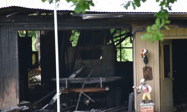 Fire destroys building, classic cars