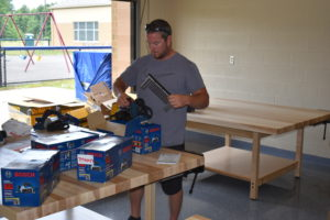Adam Hughes, who will teach Brookfield High School's new pre-apprenticeship program, unpacks tools that will be used to teach students carpentry skills.