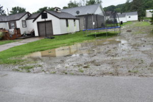 After a recent heavy rain, water floods a yard at Second and Miller streets in Masury, the site of a recent drainage improvement project.
