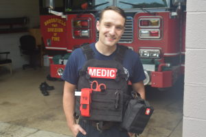 Brookfield firefighter Kyle Stern wears a bullet-proof vest the department recently bought with a state grant.