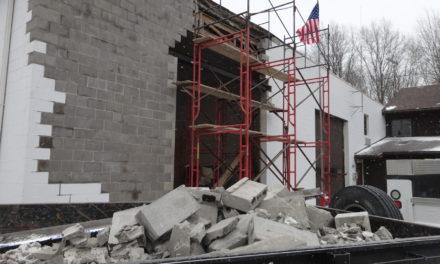 Mason vows to rebuild sagging wall