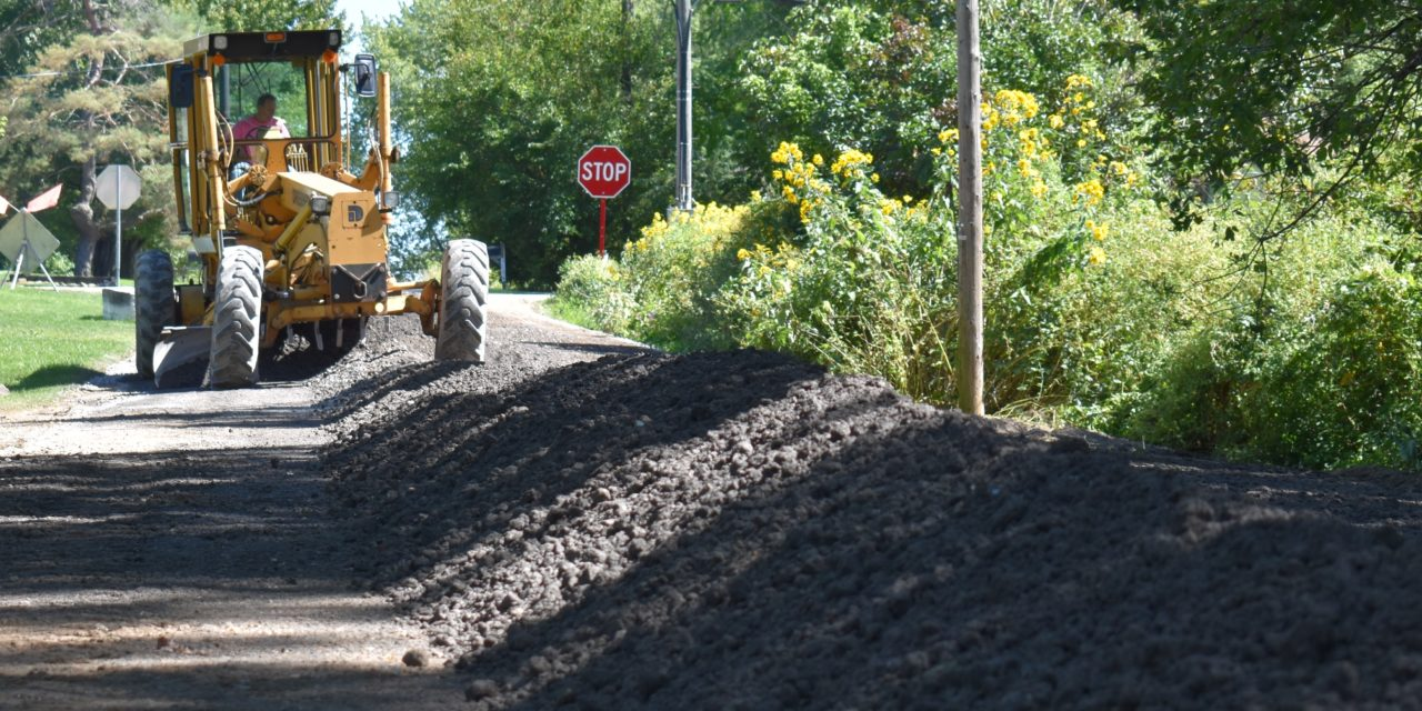 Road crew upgrades unaccepted roads
