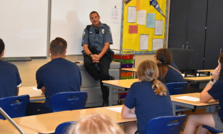 Board approves pact for cop in school