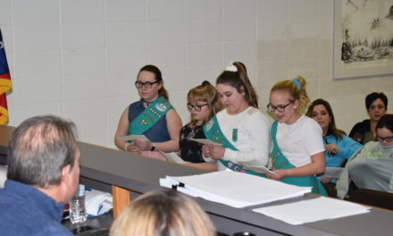 Girl Scouts on trail to park improvement