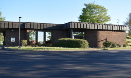 School buys bank building for administrative offices