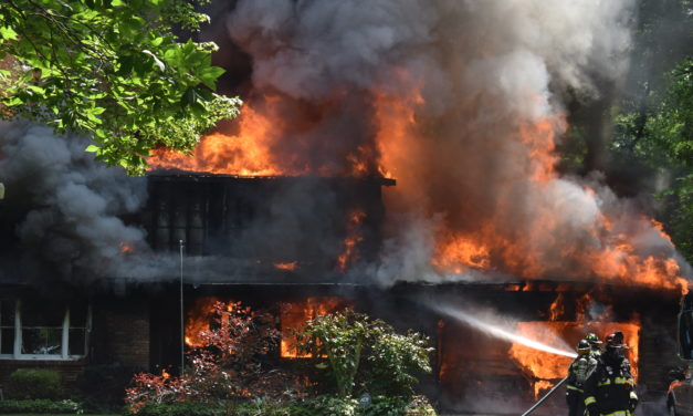 Explosions, fire destroy home